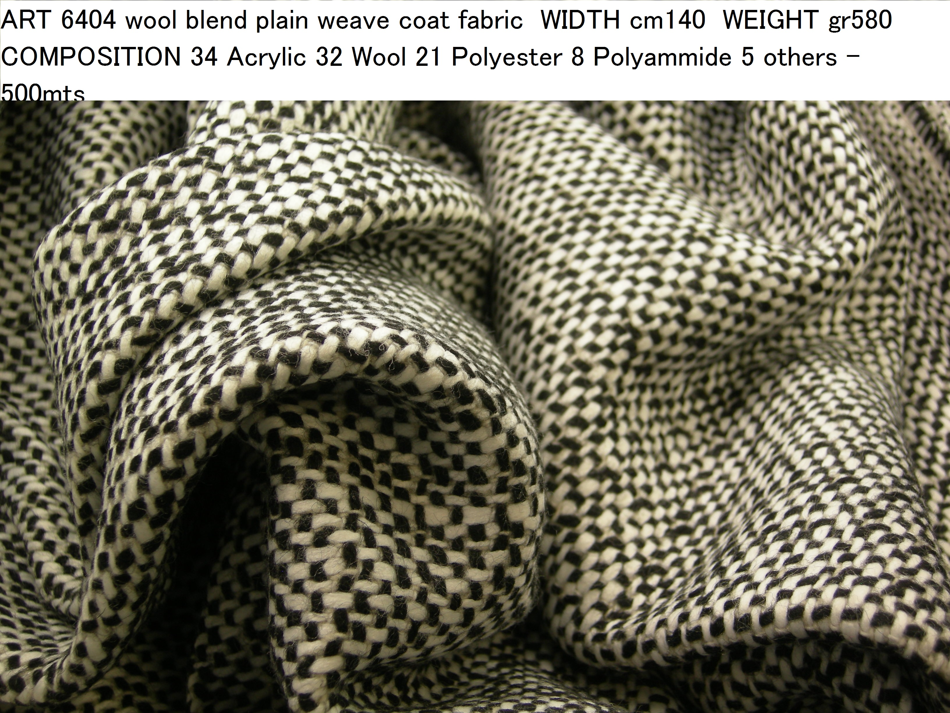 ART 6404 wool blend plain weave coat fabric WIDTH cm140 WEIGHT gr580 COMPOSITION 34 Acrylic 32 Wool 21 Polyester 8 Polyammide 5 others - 500mts