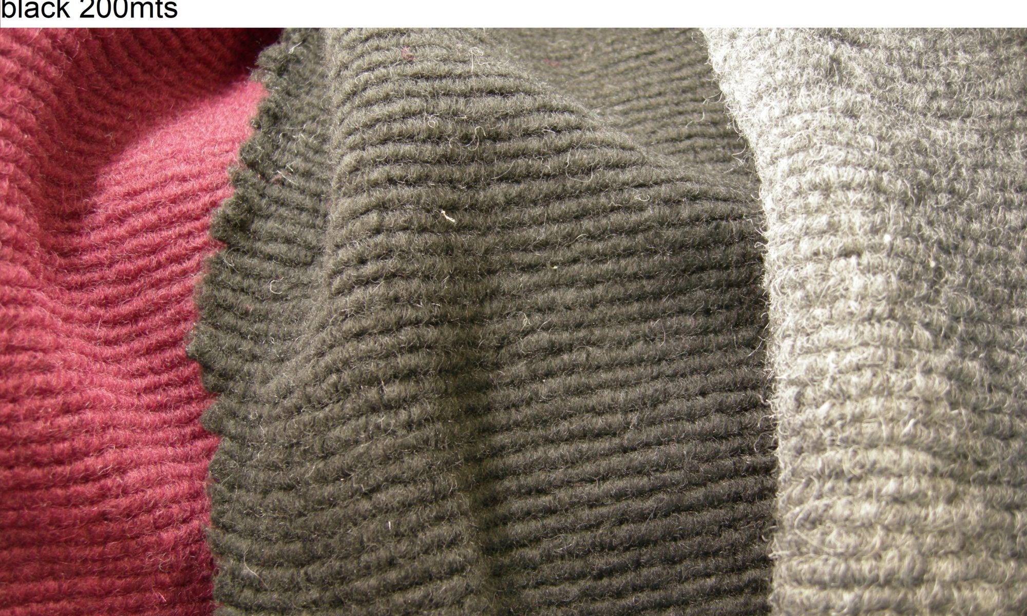 ART 7136 rib boiled wool coat fabric WIDTH cm160 WEIGHT gr460 COMPOSITION 60 polyester 37 wool 3 others - Red 100mts – grey and black 200mts