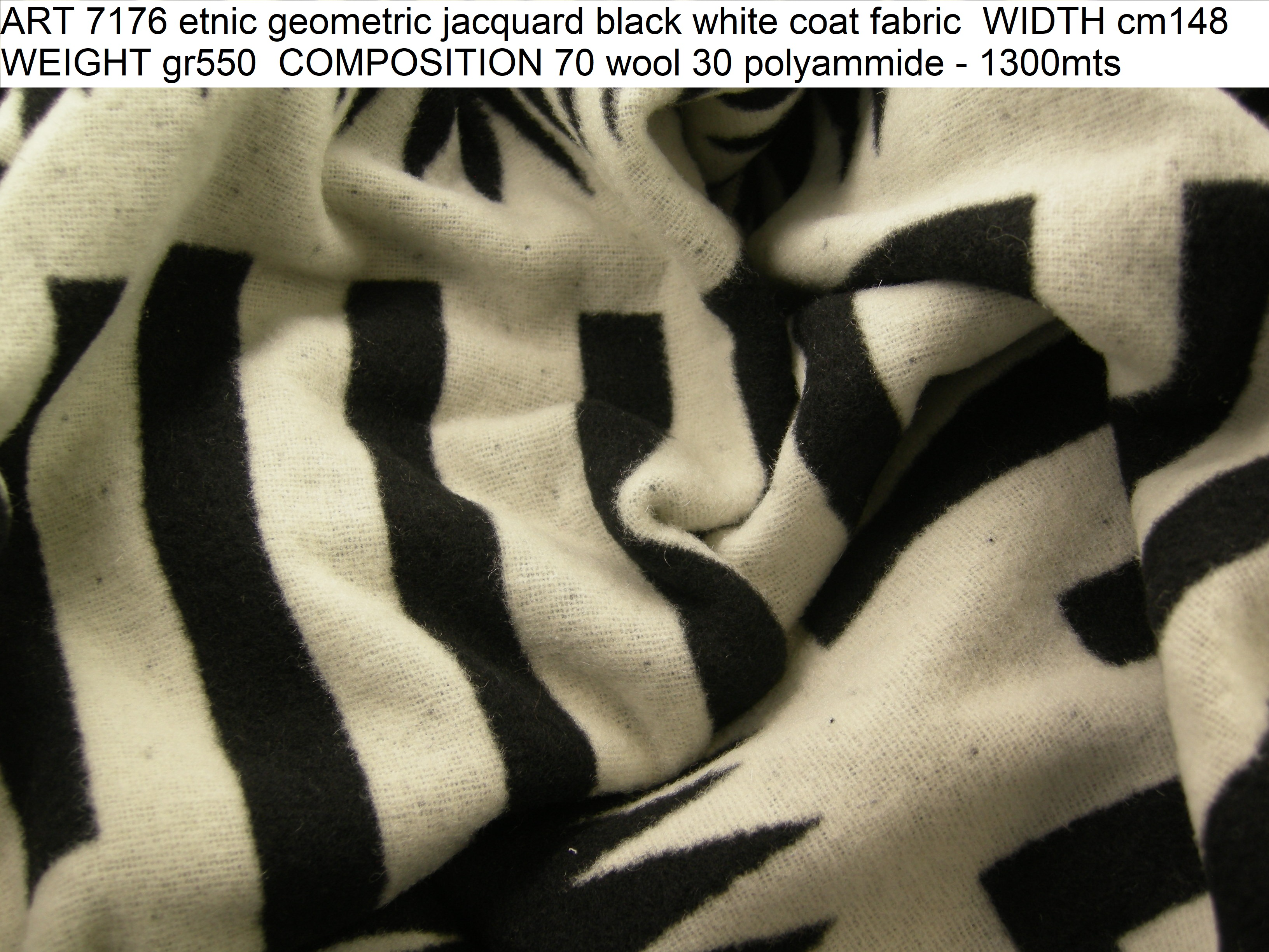 ART 7176 etnic geometric jacquard black white coat fabric WIDTH cm148 WEIGHT gr550 COMPOSITION 70 wool 30 polyammide - 1300mts