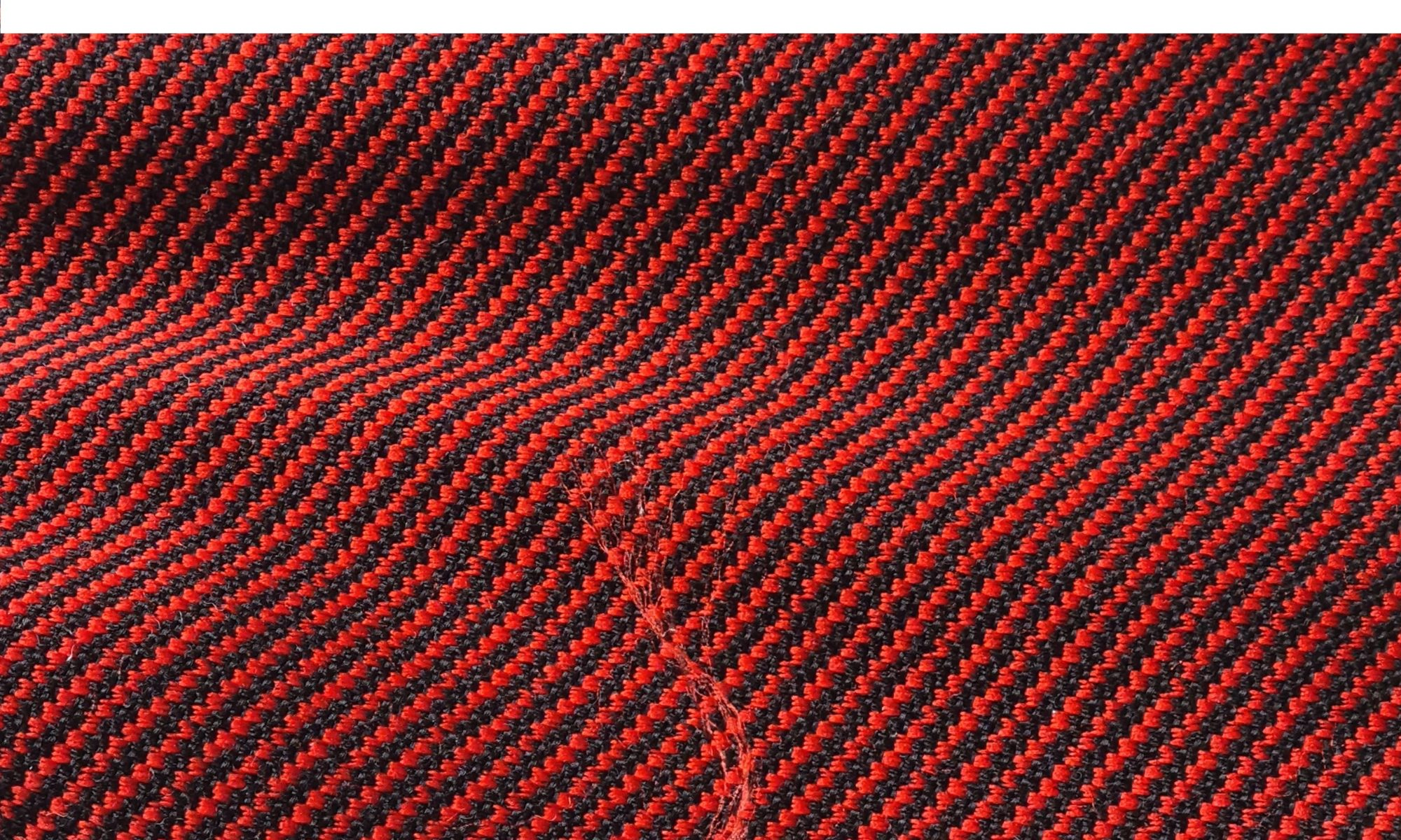 7570 red and black drill jacket fabric WIDTH cm137 WEIGHT gr460 - gr335 square meter - COMPOSITION 59 wool 41 polyester - 650mts