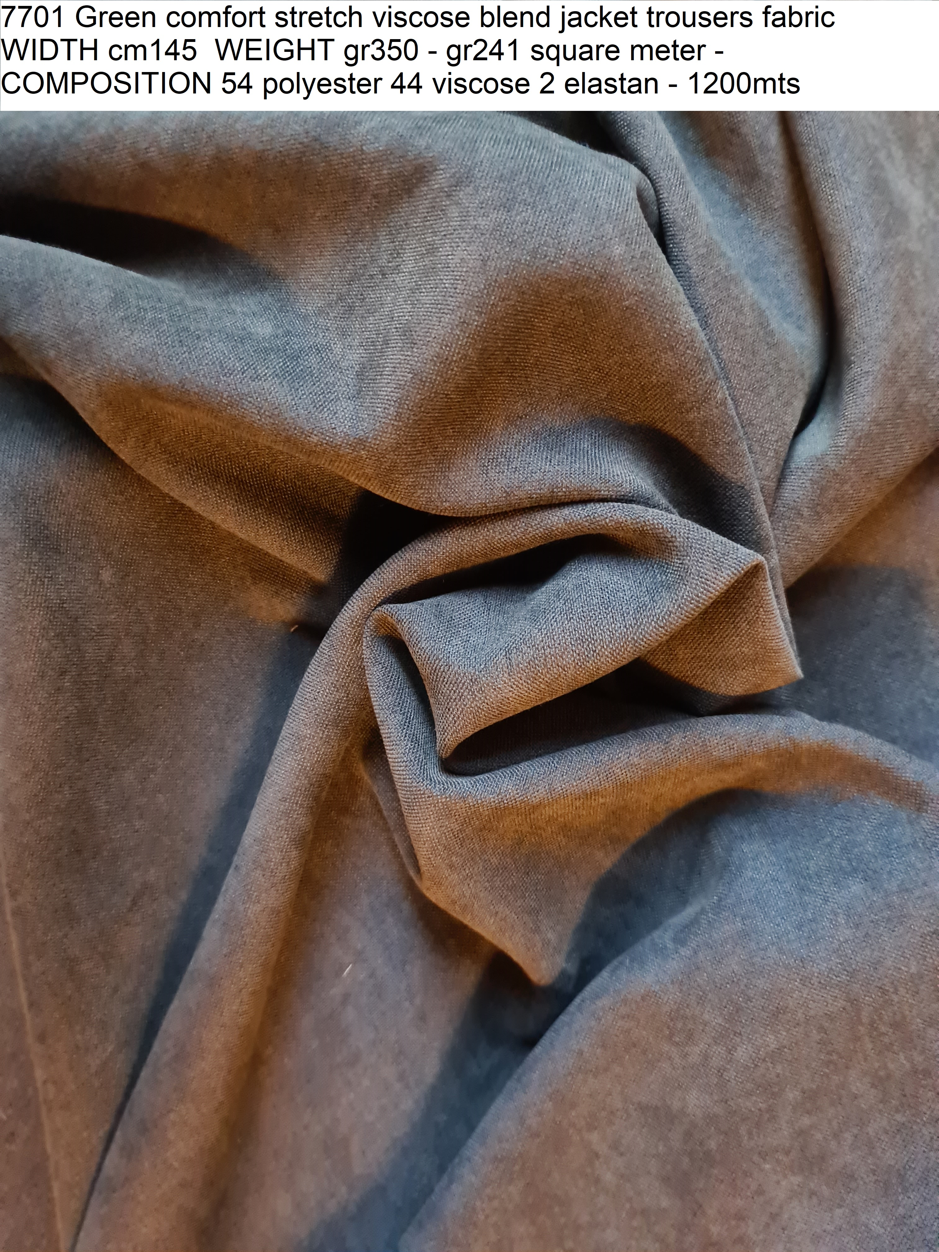 7701 Green comfort stretch viscose blend jacket trousers fabric WIDTH cm145 WEIGHT gr350 - gr241 square meter - COMPOSITION 54 polyester 44 viscose 2 elastan - 1200mts
